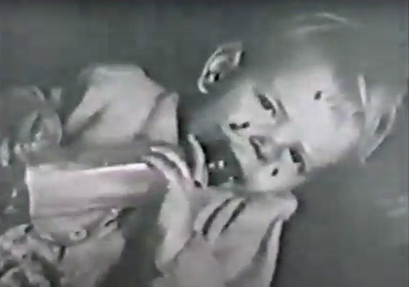 This still from Tucker's 1947 film 'Beautiful Melbourne' shows a toddler crawling with house lice. The film was made to illustrate the poor living conditions that many families in Melbourne were still experiencing eight years after the Housing Commission of Victoria was established in 1938 to address inner suburban housing.