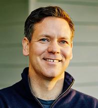 Headshot of a man smiling