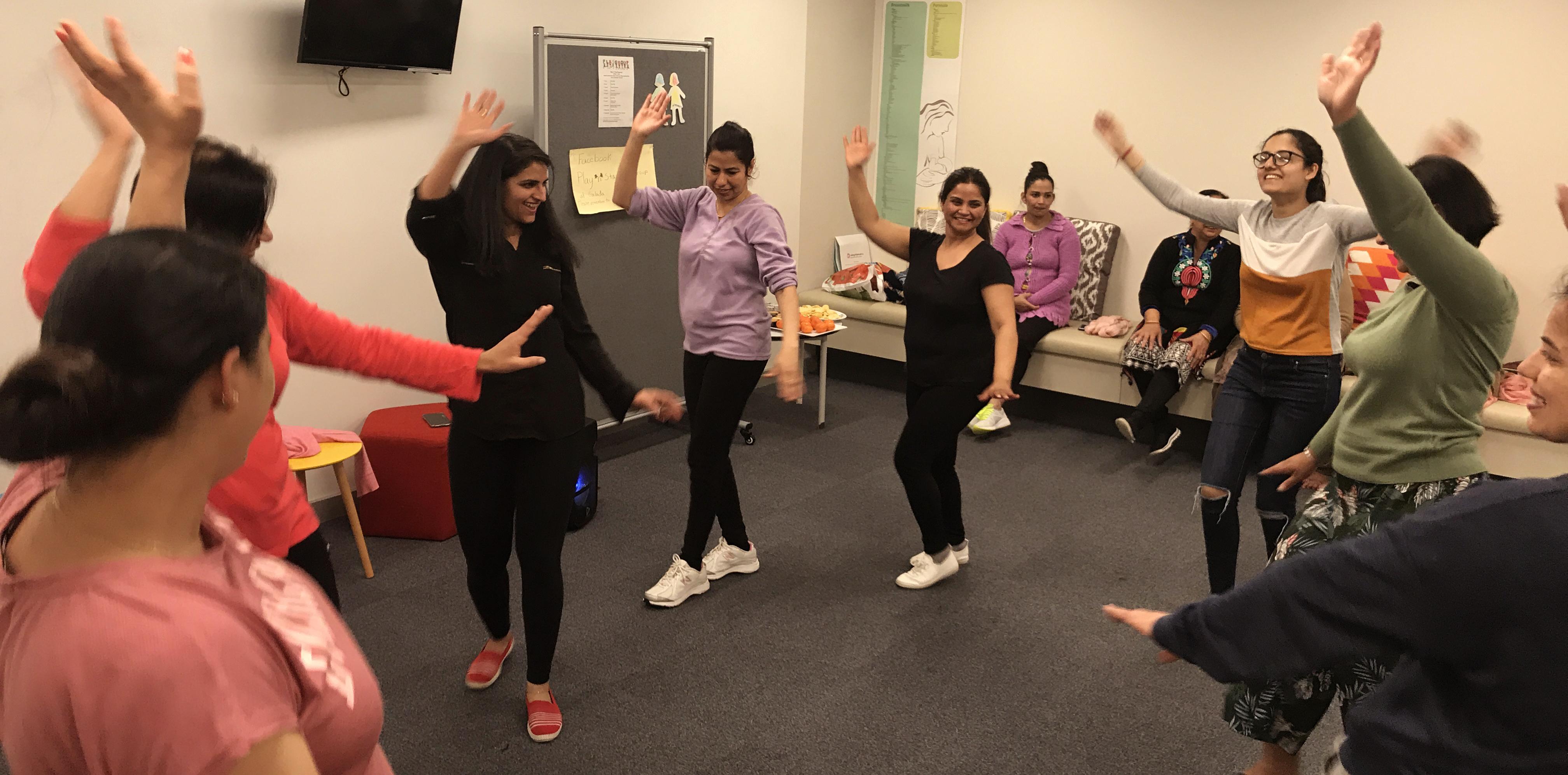 Women dance in a classroom.