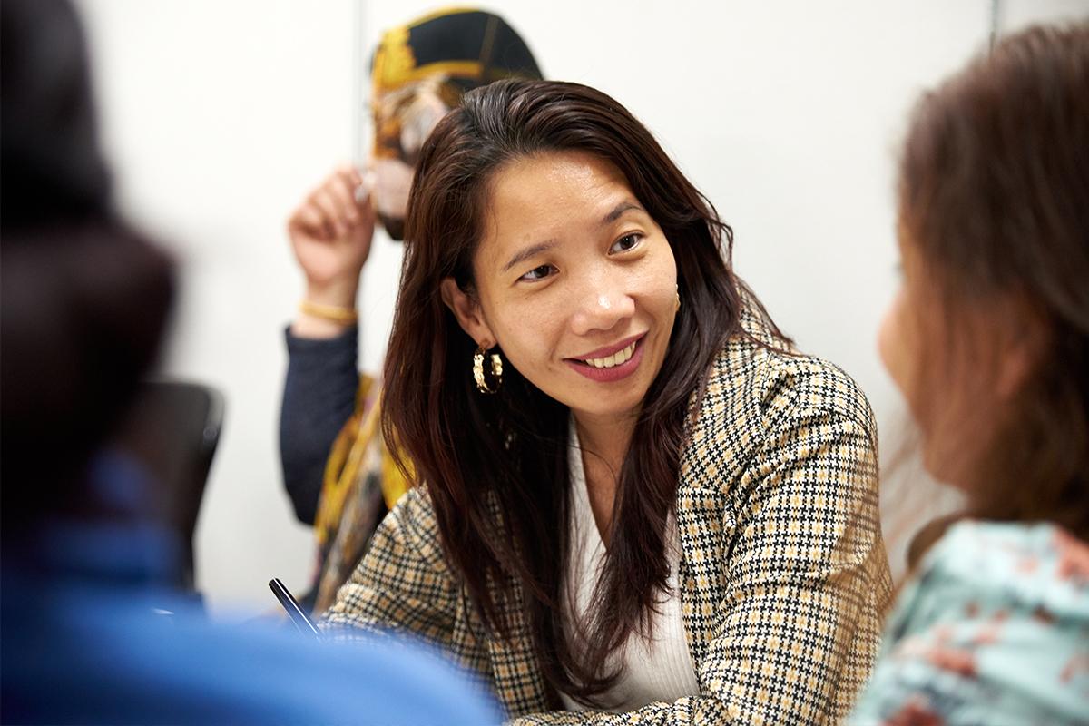 Local community members enjoy English conversation class at the Epping Hub. Photo by Martin Wurt